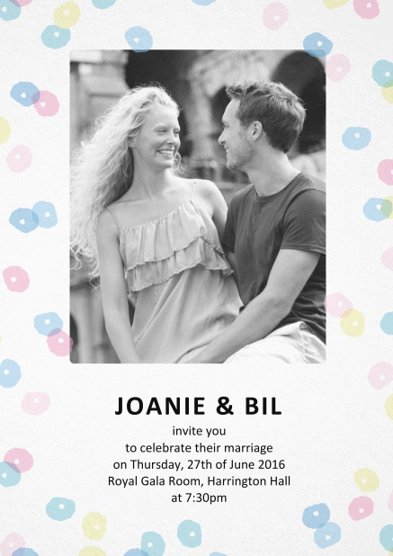 Wedding invitation card with coloruful circles around a photo and text.