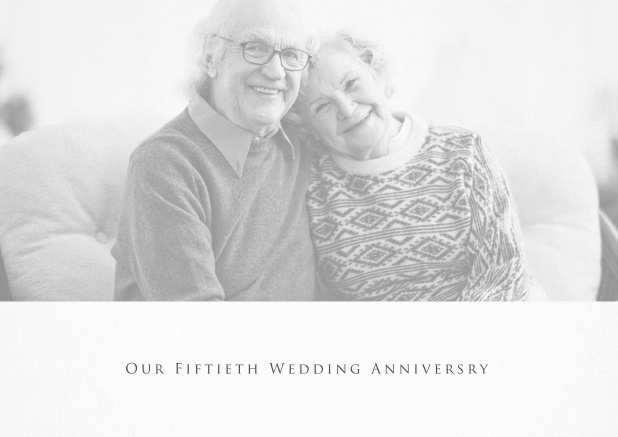 White anniversary invitation card with photo and text.