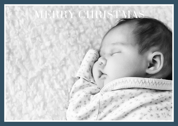 Christmas photo card with text on photo field and blue frame.
