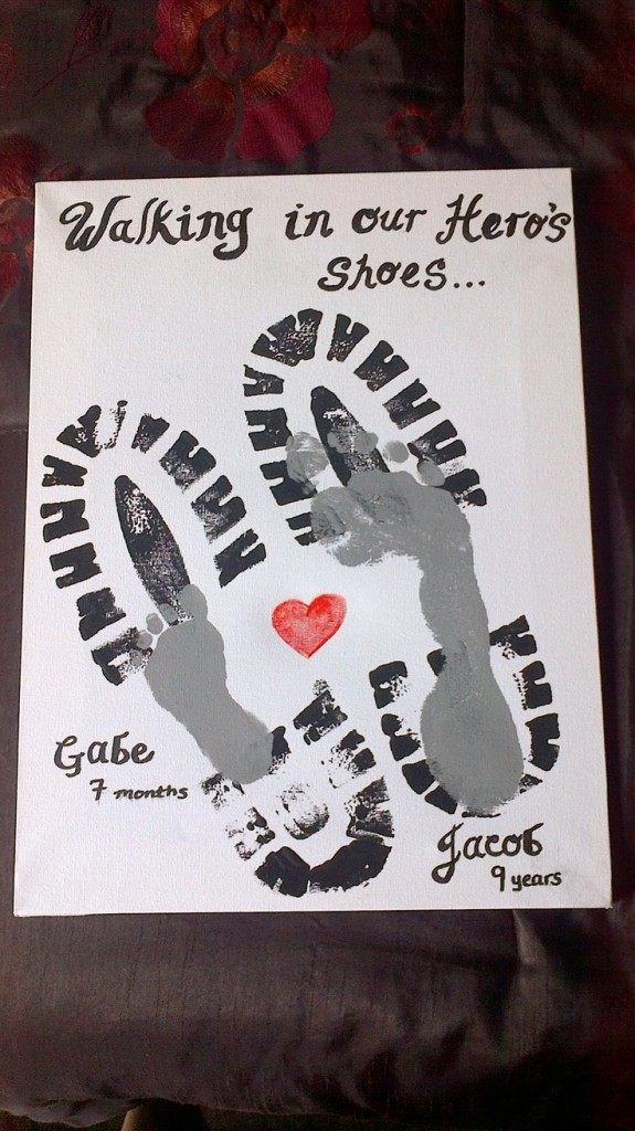 "Footprint of father and son with heart and slogan ""Walking in my Hero's shoes"""