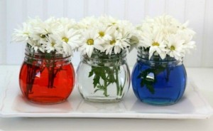 Three vases in blue, red, white