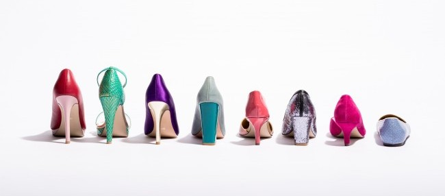 Lined up, colorful shoes, from Flats to High Heels.