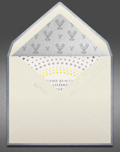 Creme envelope with silver lining opened